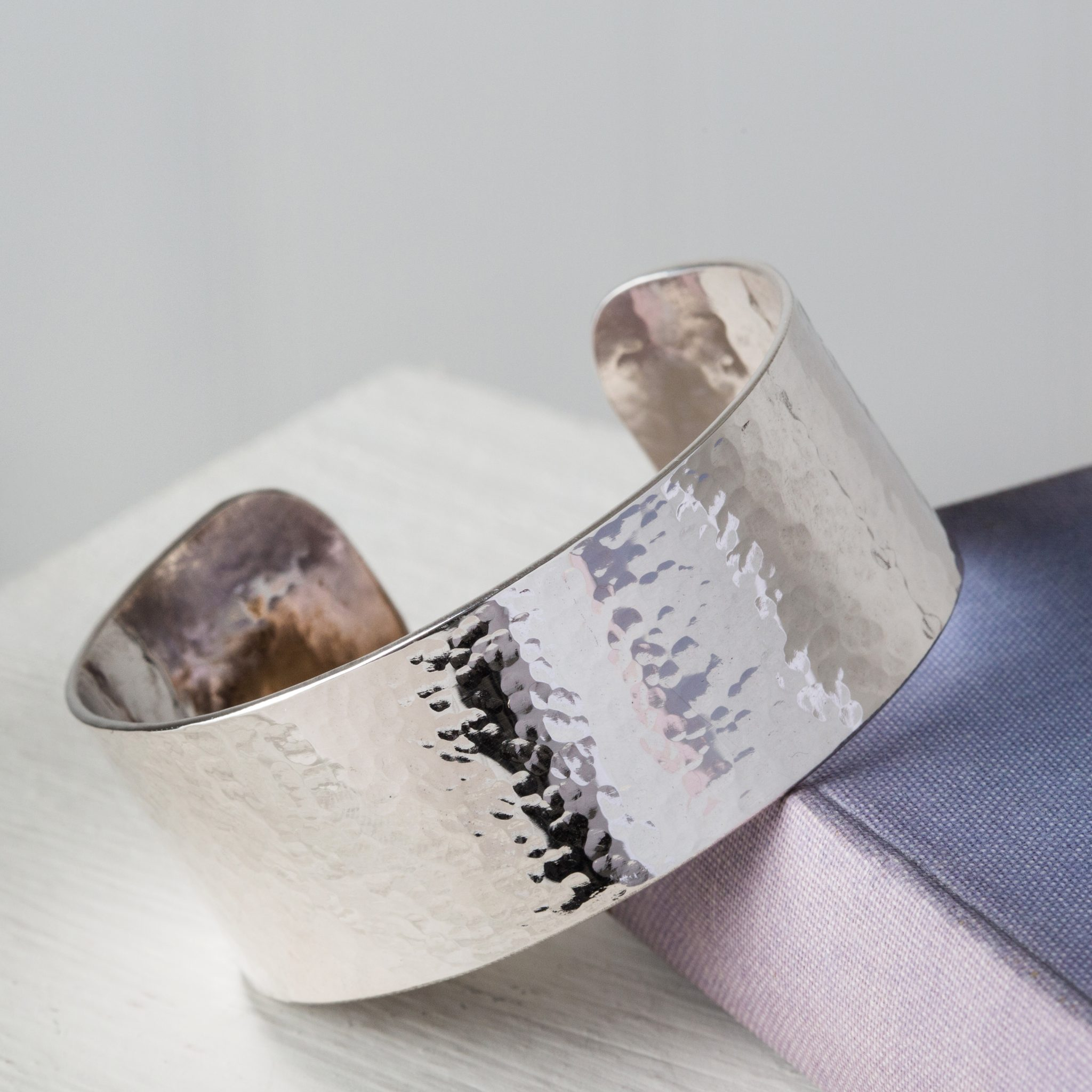 Handcrafted sterling silver cuff stamped with your choice of phrase and hallmarked at the edinburgh assay office.