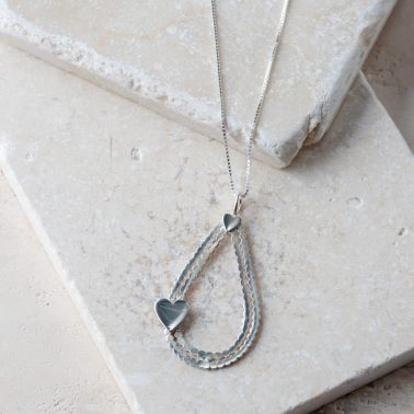 Charming sterling silver necklace with a large teardrop and heart pendant