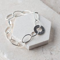 Sterling silver navette chain bracelet The central ring is engraved on one side with LOVE YOU MUM and the other can be personalised with a name.